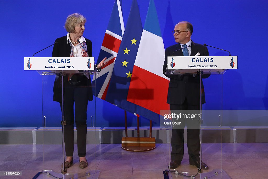 Britain's Home Secretary <a gi-track='captionPersonalityLinkClicked' href=/galleries/search?phrase=Theresa+May&family=editorial&specificpeople=832274 ng-click='$event.stopPropagation()'>Theresa May</a> and French Interior Minister <a gi-track='captionPersonalityLinkClicked' href=/galleries/search?phrase=Bernard+Cazeneuve&family=editorial&specificpeople=4205153 ng-click='$event.stopPropagation()'>Bernard Cazeneuve</a> speak to the media at a press conference after signing an agreement to tackle the migrant crisis in Calais on August 20, 2015 in Calais, France. The Home Secretary arrived in Calais to announce a number of measures to deal with the migrant issue in which about 3,000 migrants are thought to be camped in Calais hoping to cross the Channel into Britain. Measures include the creation of a joint command centre to target criminals trafficking migrants into France and the UK.