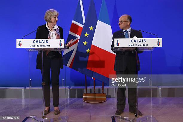 Britain's Home Secretary Theresa May and French Interior Minister Bernard Cazeneuve speak to the media at a press conference after signing an...