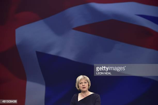 Britain's Home Secretary Theresa May gives a speech on the third day of the annual Conservative party conference in Manchester north west England on...