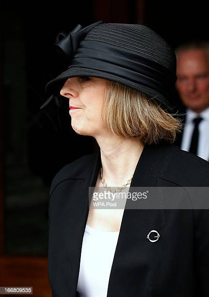 Britain's Home Secretary Theresa May leaves after attending the funeral service of former British prime minister Margaret Thatcher at St Paul's...