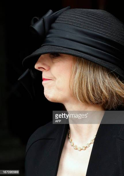 Britain's Home Secretary Theresa May leaves after attending the ceremonial funeral of British former prime minister Margaret Thatcher at St Paul's...