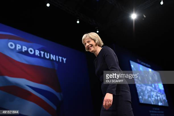 Britain's Home Secretary Theresa May leaves the stage after addressing delegates on the third day of the annual Conservative party conference in...