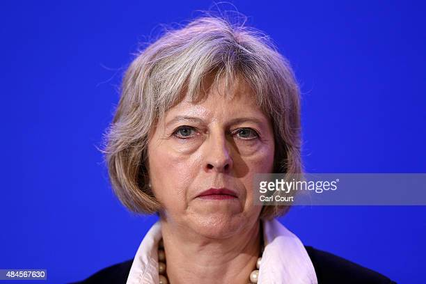 Britain's Home Secretary Theresa May speaks to the media at a press conference after signing an agreement to tackle the migrant crisis in Calais on...