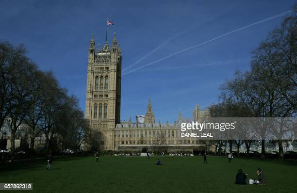 TOPSHOT Britain's Houses of Parliament comprising the House of Commons and the House of Lords are pictured in London on March 13 2017 British Prime...