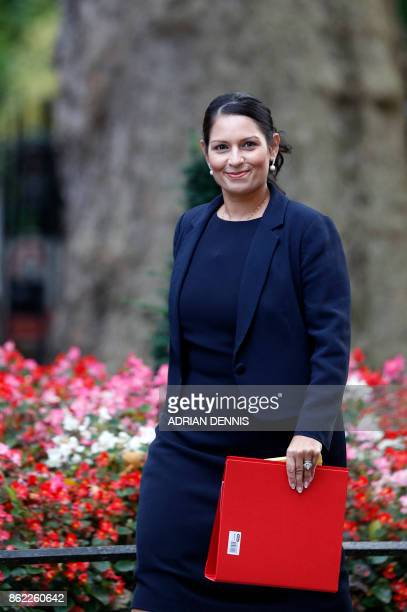 Britain's International Development Secretary Priti Patel arrives at Downing Street for the weekly meeting of the cabinet in London on October 17...