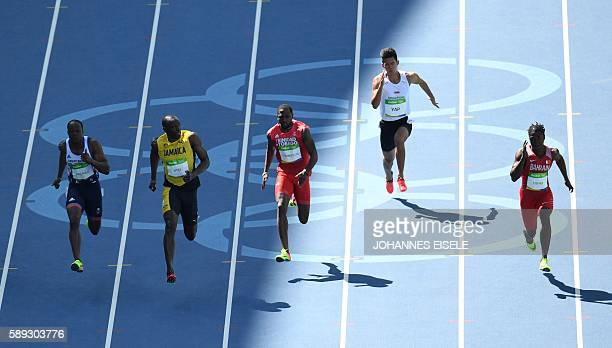 TOPSHOT Britain's James Dasaolu Jamaica's Usain Bolt Trinidad and Tobago's Richard Thompson Singapore's Yap Jin Wei Timothee and Bahrain's Andrew...