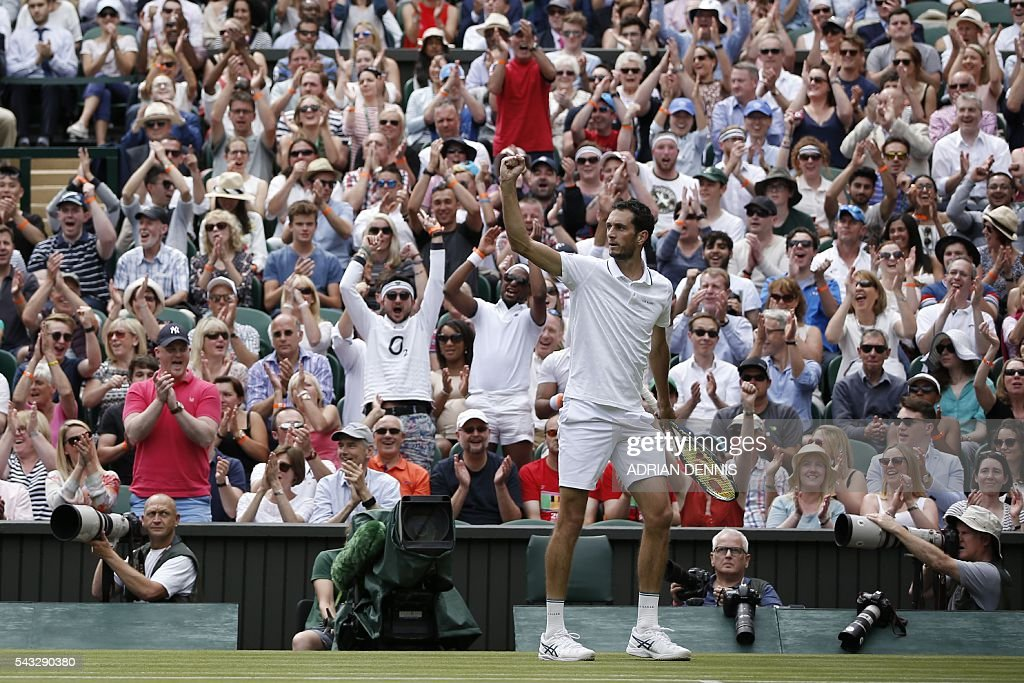 Britain's James Ward celebrates winning a game in the second set against Serbia's Novak Djokovic during their men's singles first round match on the first day of the 2016 Wimbledon Championships at The All England Lawn Tennis Club in Wimbledon, southwest London, on June 27, 2016. / AFP / ADRIAN
