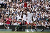 Britain's James Ward celebrates winning a game in the second set against Serbia's Novak Djokovic during their men's singles first round match on the...