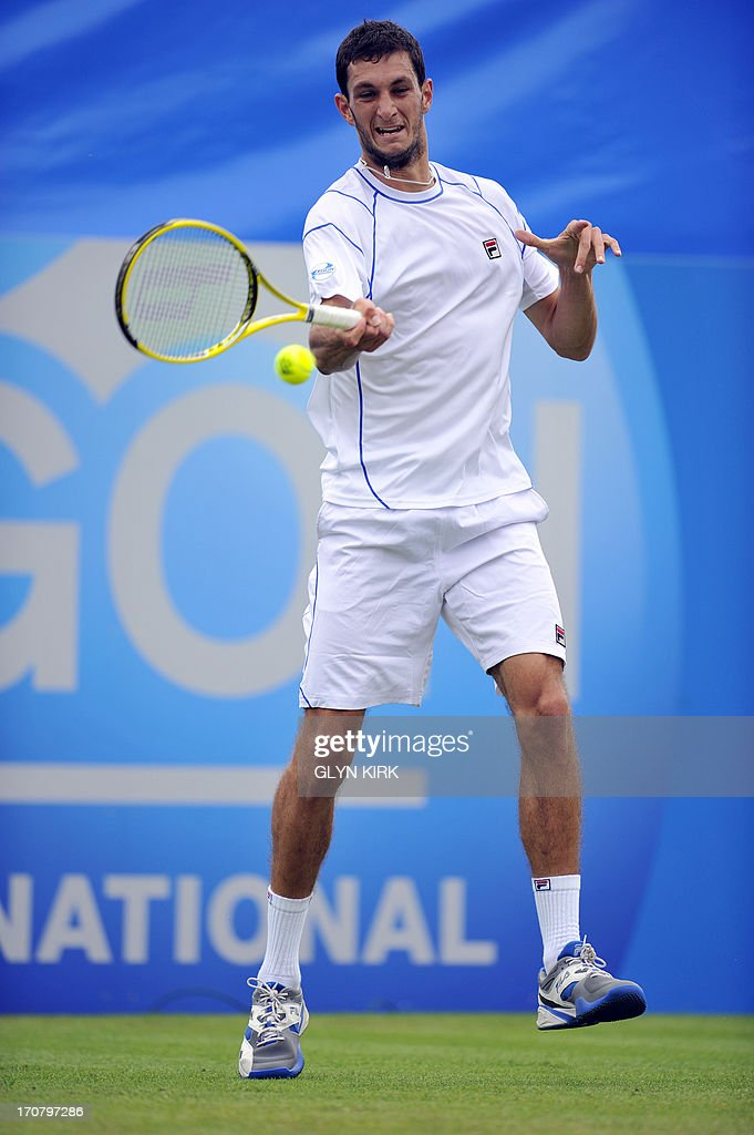 Britains James Ward returns against Australias Bernard Tomic during their men's singles match on the fourth day of the AEGON International tennis tournament in Eastbourne, southern England on June 18, 2013.