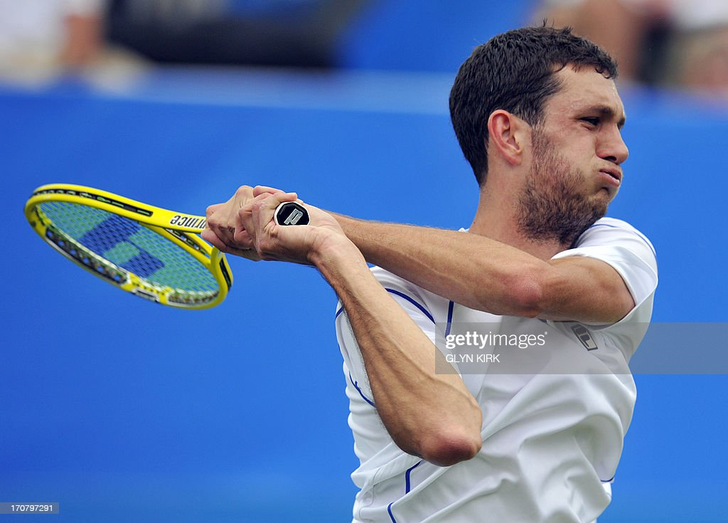 Britains James Ward returns against Australias Bernard Tomic during their men's singles match on the fourth day of the AEGON International tennis tournament in Eastbourne, southern England on June 18, 2013. AFP PHOTO/GLYN KIRK