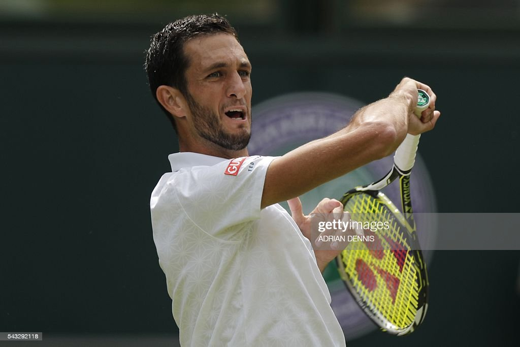 Britain's James Ward returns against Serbia's Novak Djokovic during their men's singles first round match on the first day of the 2016 Wimbledon Championships at The All England Lawn Tennis Club in Wimbledon, southwest London, on June 27, 2016. / AFP / ADRIAN