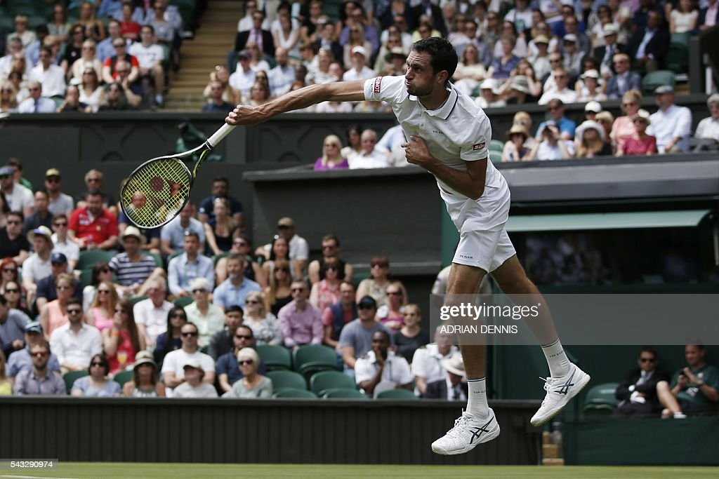 Britain's James Ward serves against Serbia's Novak Djokovic during their men's singles first round match on the first day of the 2016 Wimbledon Championships at The All England Lawn Tennis Club in Wimbledon, southwest London, on June 27, 2016. / AFP / ADRIAN