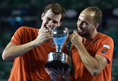 Britain's Jamie Murray and Brazil's Bruno Soares pose with the trophy as they celebrate after victory in their men's doubles final match against...