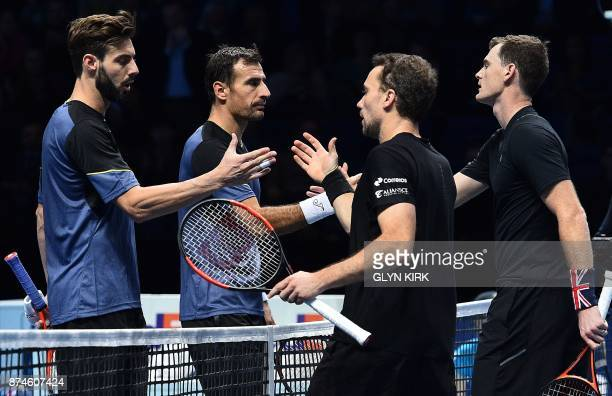 Britain's Jamie Murray and Brazil's Bruno Soares shake hands with play against Croatia's Ivan Dodig and BosniaHerzegovina's Marcel Granollers during...