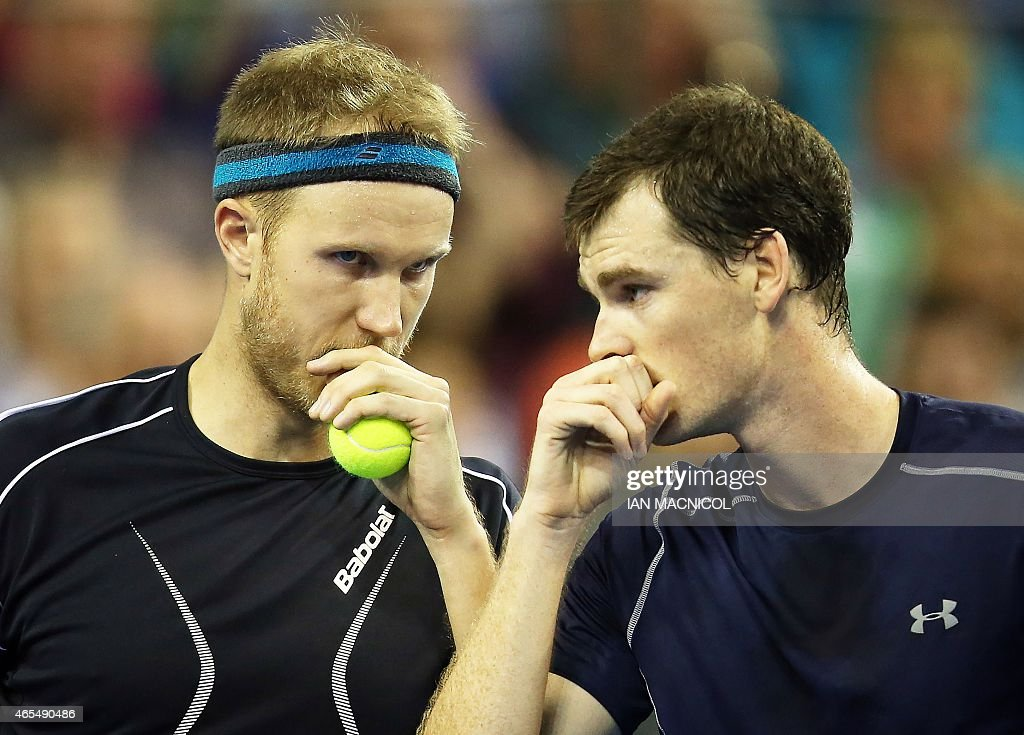 Britain's Jamie Murray and Dominic Inglot speak as they compete against Mike Bryan and Bob Bryan of US during the Davis Cup third round doubles...