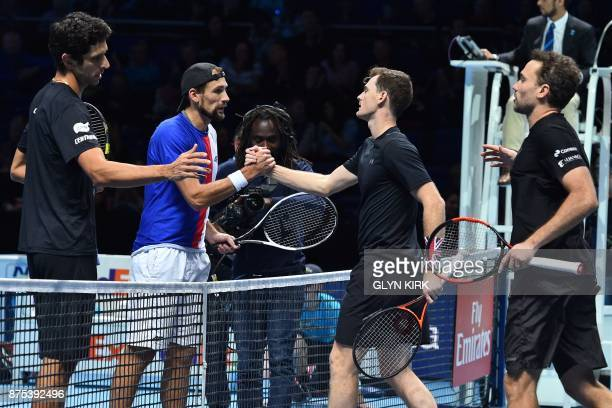 Britain's Jamie Murray and his partner Brazil's Bruno Soares shakes hands with Brazil's Marcelo Melo and Poland's Lukasz Kubot after winning their...