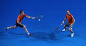 Britain's Jamie Murray plays a shot past partner Brazil's Bruno Soares during their men's doubles final match against Canada's Daniel Nestor and...
