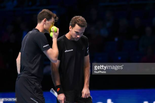 Britain's Jamie Murray speaks with his partner Brazil's Bruno Soares during their men's doubles roundrobin match against Brazil's Marcelo Melo and...