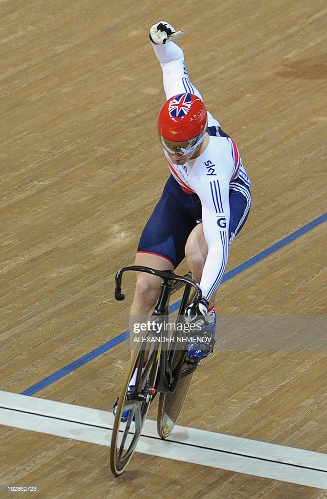 Britain's Jason Kenny crosses the finish line winning gold in Men's Keirin event during the UCI Track Cycling World Championships in Minsk on February 22, 2013