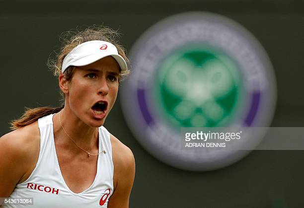 Britain's Johanna Konta celebrates a point against Puerto Rico's Monica Puig during their women's singles first round match on the third day of the...