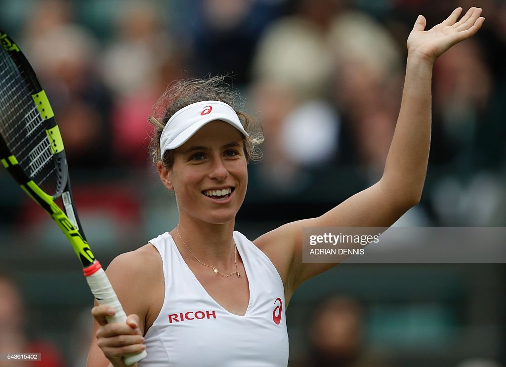 Britain's Johanna Konta celebrates after beating Puerto Rico's Monica Puig during their women's singles first round match on the third day of the 2016 Wimbledon Championships at The All England Lawn Tennis Club in Wimbledon, southwest London, on June 29, 2016. / AFP / ADRIAN