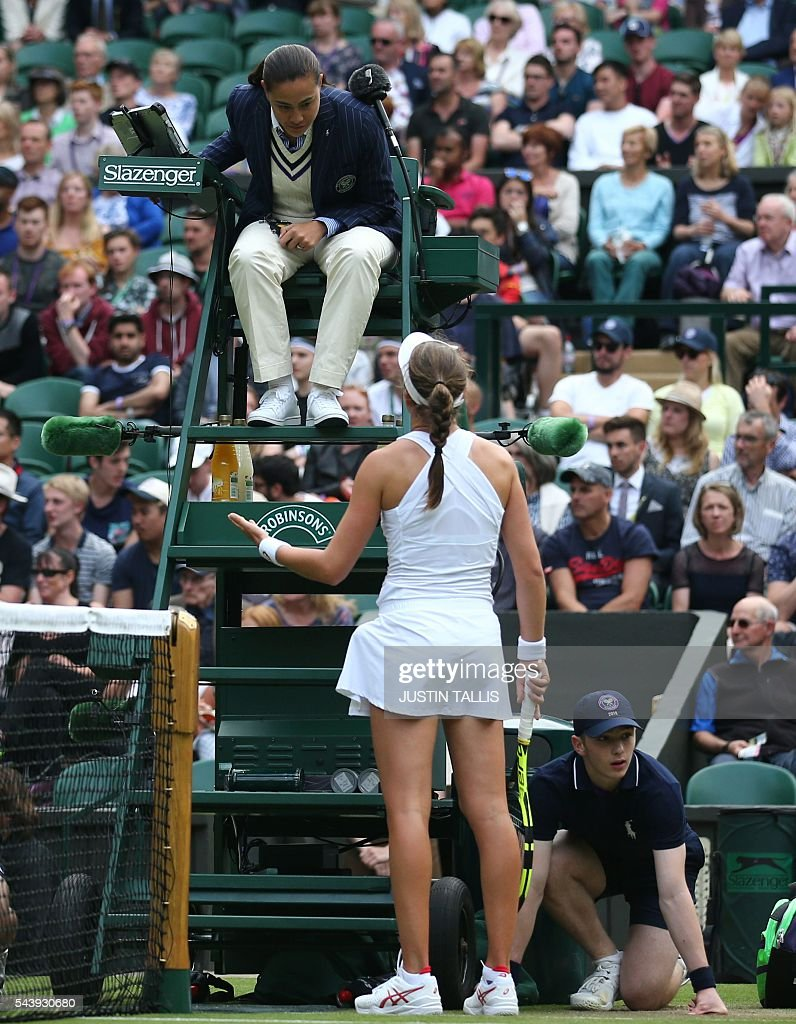Britain's Johanna Konta questions the umpire's call while playing Canada's Eugenie Bouchard during their women's singles second round match on the fourth day of the 2016 Wimbledon Championships at The All England Lawn Tennis Club in Wimbledon, southwest London, on June 30, 2016. / AFP / JUSTIN