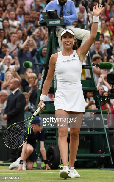 Britain's Johanna Konta reacts after beating Romania's Simona Halep during their women's singles quarterfinal match on the eighth day of the 2017...
