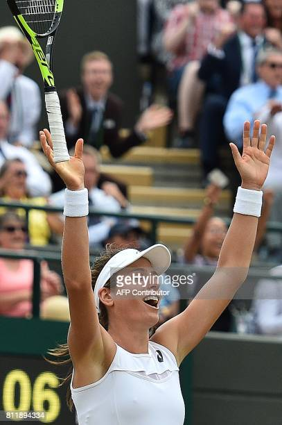 Britain's Johanna Konta reacts after winning against France's Caroline Garcia during their women's singles fourth round match on the seventh day of...
