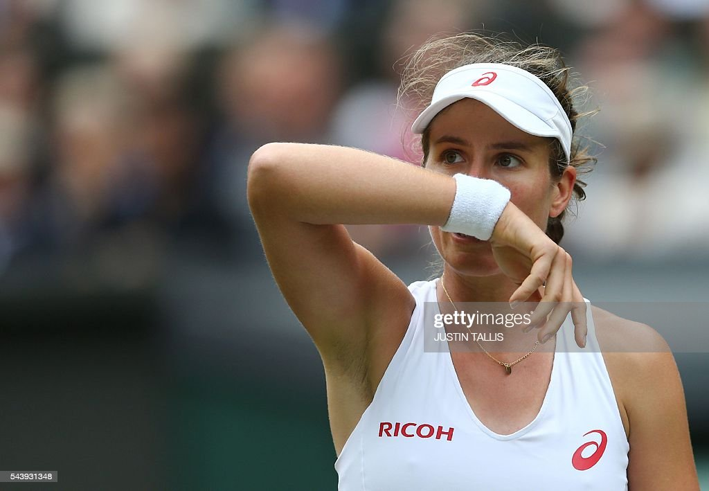 Britain's Johanna Konta reacts while playing Canada's Eugenie Bouchard during their women's singles second round match on the fourth day of the 2016 Wimbledon Championships at The All England Lawn Tennis Club in Wimbledon, southwest London, on June 30, 2016. / AFP / JUSTIN