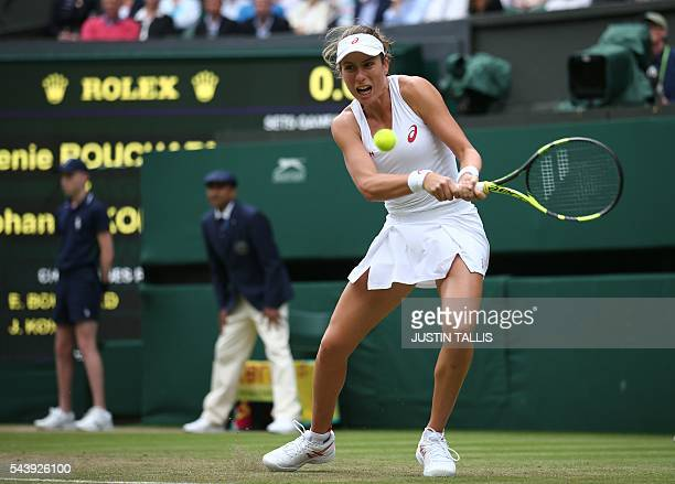 Britain's Johanna Konta retuns to Canada's Eugenie Bouchard during their women's singles second round match on the fourth day of the 2016 Wimbledon...