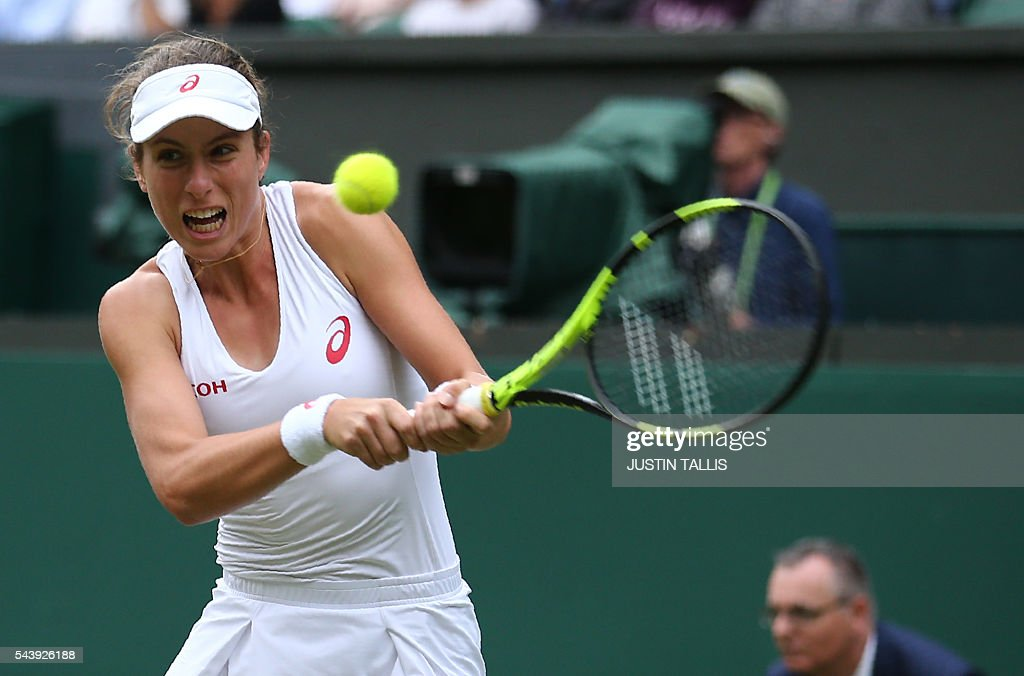 Britain's Johanna Konta retuns to Canada's Eugenie Bouchard during their women's singles second round match on the fourth day of the 2016 Wimbledon Championships at The All England Lawn Tennis Club in Wimbledon, southwest London, on June 30, 2016. / AFP / JUSTIN