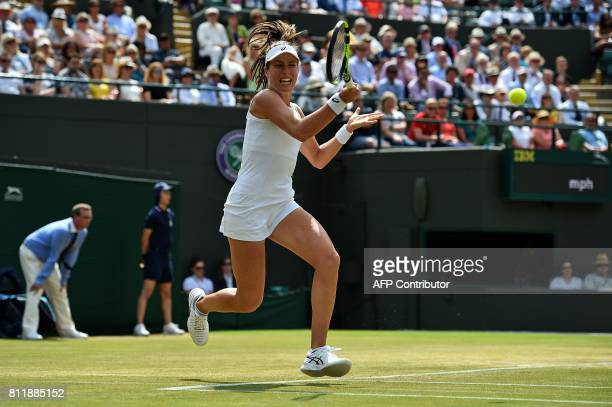 Britain's Johanna Konta returns against France's Caroline Garcia during their women's singles fourth round match on the seventh day of the 2017...