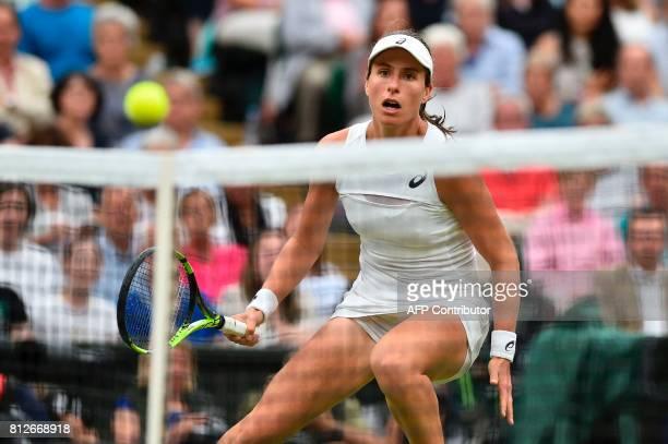 Britain's Johanna Konta returns against Romania's Simona Halep during their women's singles quarterfinal match on the eighth day of the 2017...