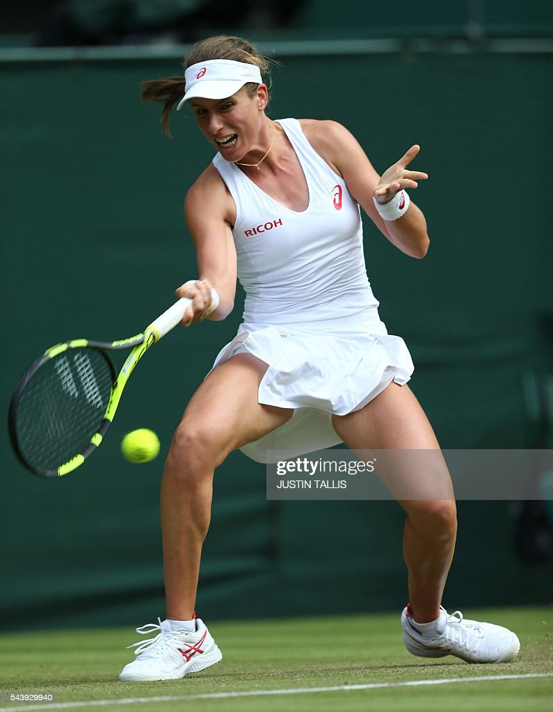 Britain's Johanna Konta returns to Canada's Eugenie Bouchard during their women's singles second round match on the fourth day of the 2016 Wimbledon Championships at The All England Lawn Tennis Club in Wimbledon, southwest London, on June 30, 2016. / AFP / JUSTIN