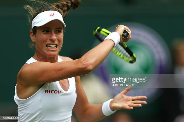 Britain's Johanna Konta returns to Canada's Eugenie Bouchard during their women's singles second round match on the fourth day of the 2016 Wimbledon...