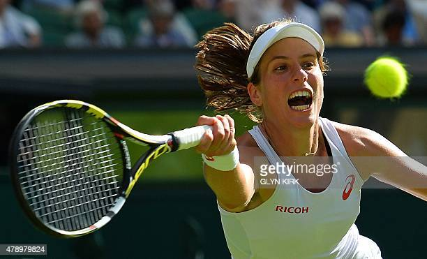 Britain's Johanna Konta returns to Russia's Maria Sharapova during their women's singles first round match on day one of the 2015 Wimbledon...