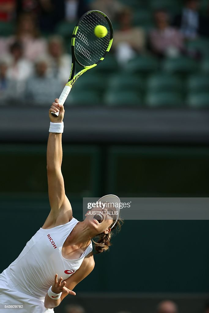 Britain's Johanna Konta serves to Canada's Eugenie Bouchard during their women's singles second round match on the fourth day of the 2016 Wimbledon Championships at The All England Lawn Tennis Club in Wimbledon, southwest London, on June 30, 2016. / AFP / JUSTIN