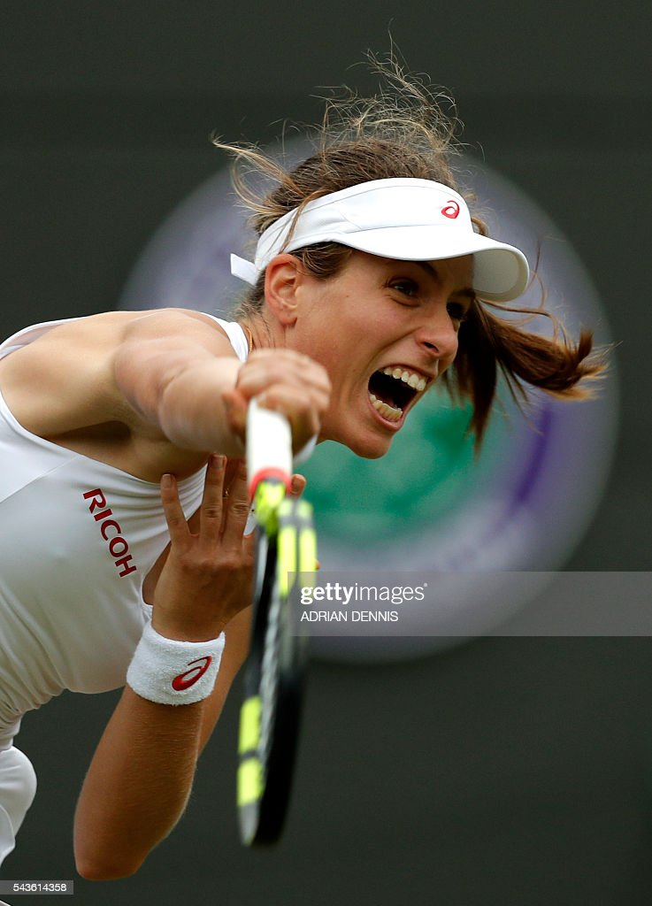 Britain's Johanna Konta serves to Puerto Rico's Monica Puig during their women's singles first round match on the third day of the 2016 Wimbledon Championships at The All England Lawn Tennis Club in Wimbledon, southwest London, on June 29, 2016. / AFP / ADRIAN