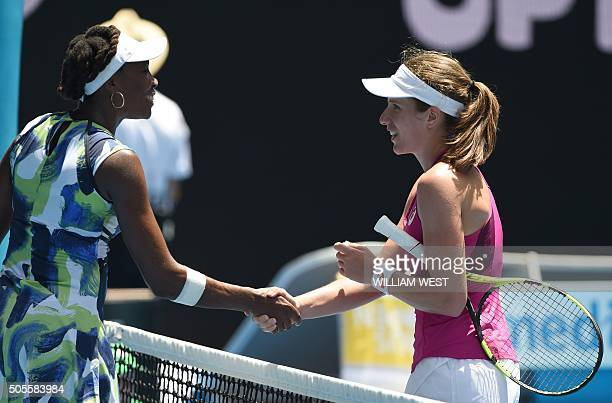 Britain's Johanna Konta shakes hands as she celebrates after victory in her women's singles match against Venus Williams of the US on day two of the...