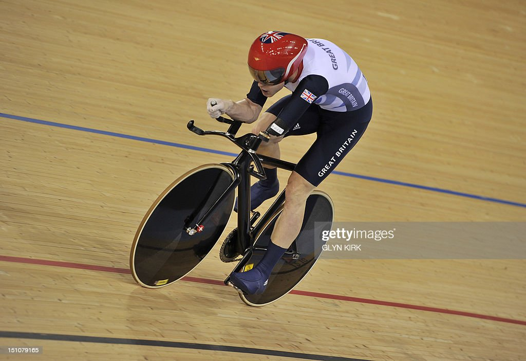 Britain's JonAllan Butterworth competes in the men's individual C45 1km time trial cycling event during the London 2012 Paralympic Games at the...