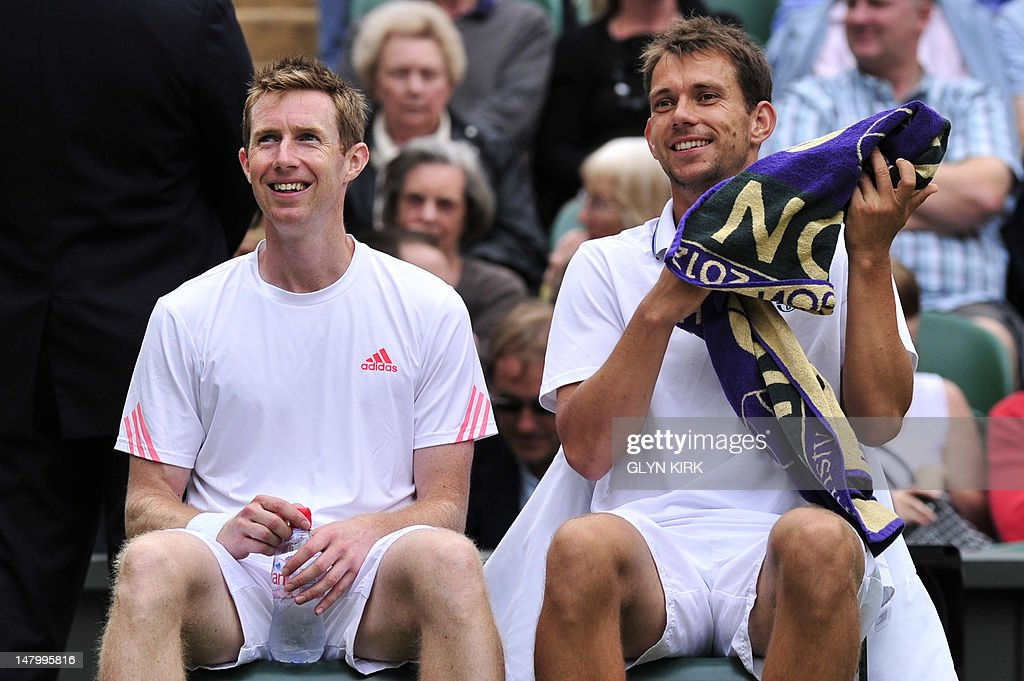 Britain's Jonathan Marray (L) and Denmark's Frederik Nielsen (R) sitting during a break between games during their men's doubles final match against Swedan's Robert Lindstedt and Romania's Horia Tecau on day 12 of the 2012 Wimbledon Championships tennis tournament at the All England Tennis Club in Wimbledon, southwest London, on July 7, 2012.