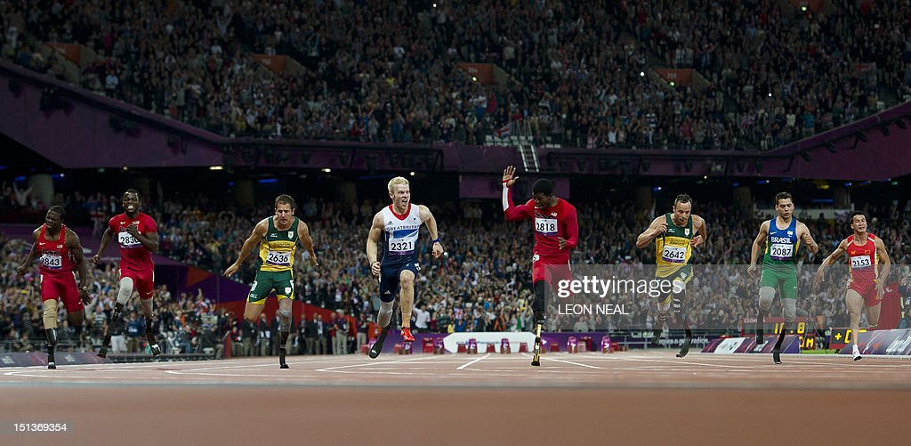 Britain's Jonnie Peacock (4L) crosses the line first to win ahead of (L-R) US athlete Jerome Singleton, US athlete Blake Leeper, South Africa's Arnu Fourie, US athlete Richard Brown, South Africa's Oscar Pistorius, Brazil's Alan Fonteles Cardoso Oliveira and China's Liu Zhiming in the men's 100m T44 final during the athletics competition at the London 2012 Paralympic Games at the Olympic Stadium in east London on September 6, 2012. Peacock won gold, Brown the second and Fourie the bronze with Pistorius fourth and Oliveira seventh.