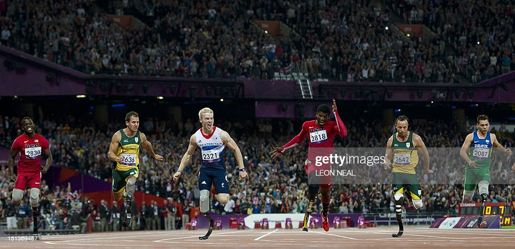 Britain's Jonnie Peacock (3L) crosses the line first to win ahead of (L-R) US athlete Blake Leeper, South Africa's Arnu Fourie, US athlete Richard Brown, South Africa's Oscar Pistorius and Brazil's Alan Fonteles Cardoso Oliveira in the men's 100m T44 final during the athletics competition at the London 2012 Paralympic Games at the Olympic Stadium in east London on September 6, 2012. Peacock won gold, Brown the second and Fourie the bronze with Pistorius fourth and Oliveira seventh.