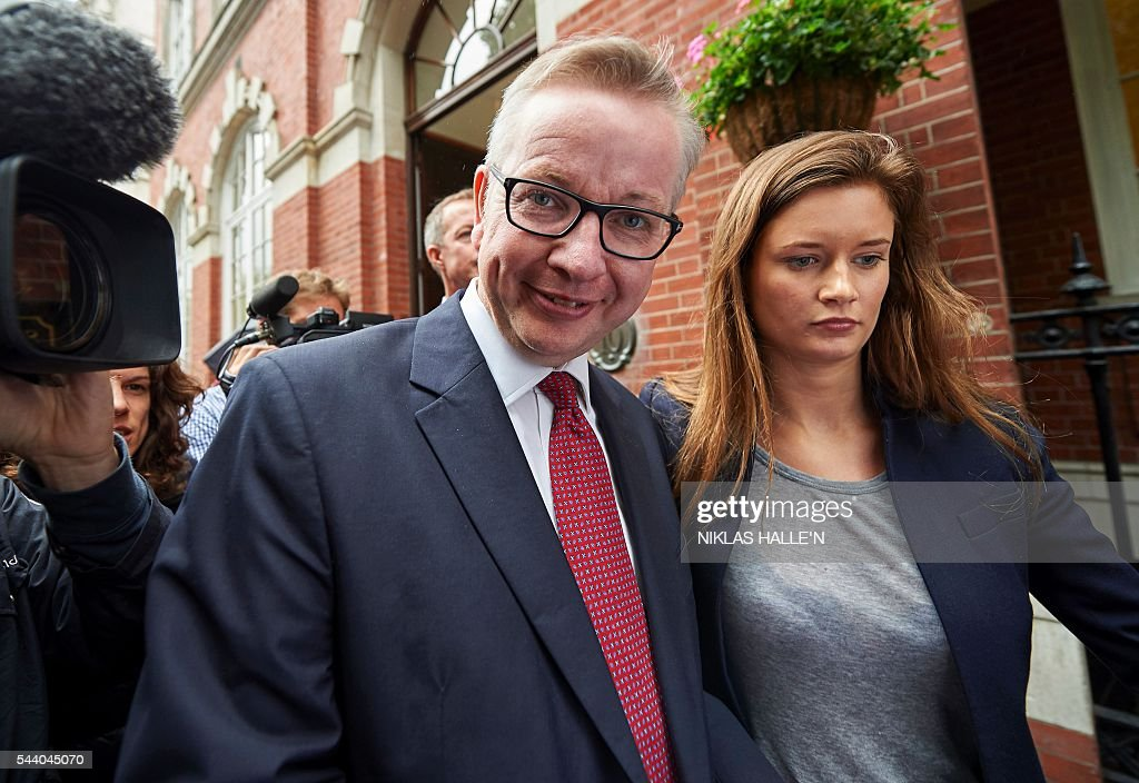Britain's Justice Minister Michael Gove (L) leaves after addressing a press conference in central London on July 1, 2016. A bespectacled intellectual with a low-key public image, Michael Gove emerged as an unlikely force behind the Brexit campaign and a wily political player after rebelling against his former friend and ally, Prime Minister David Cameron. / AFP / NIKLAS HALLE'N