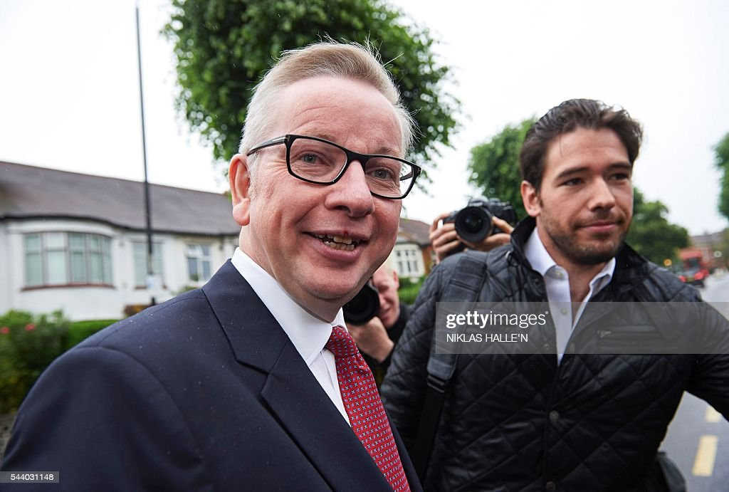 Britain's Justice Minister Michael Gove (L) leaves his home in London on July 1, 2016. A bespectacled intellectual with a low-key public image, Michael Gove emerged as an unlikely force behind the Brexit campaign and a wily political player after rebelling against his former friend and ally, Prime Minister David Cameron. / AFP / NIKLAS HALLE'N