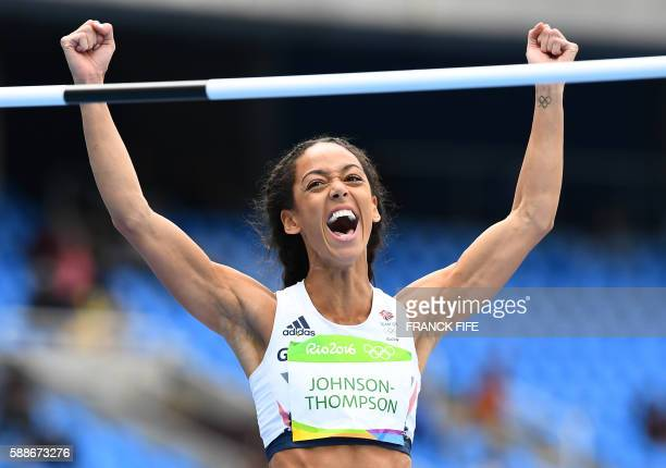 TOPSHOT Britain's Katarina JohnsonThompson reacts in the Women's Heptathlon High Jump during the athletics event at the Rio 2016 Olympic Games at the...