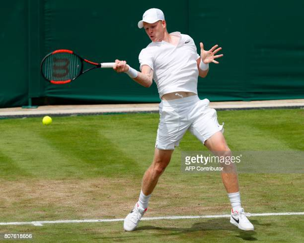 Britain's Kyle Edmund returns against Britain's Alexander Ward during their men's singles first round match on the second day of the 2017 Wimbledon...