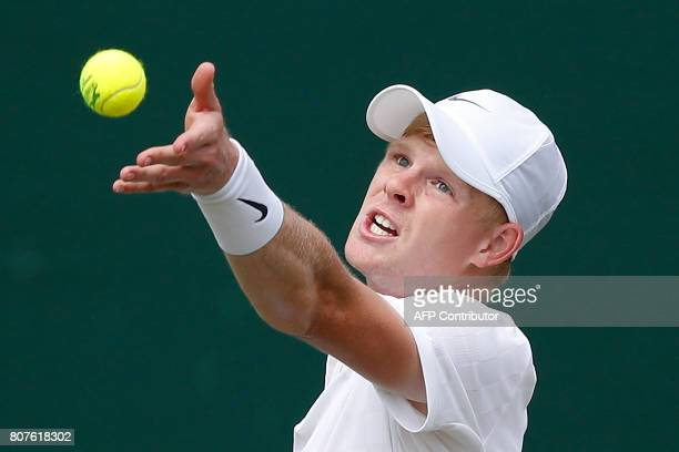Britain's Kyle Edmund serves against Britain's Alexander Ward during their men's singles first round match on the second day of the 2017 Wimbledon...