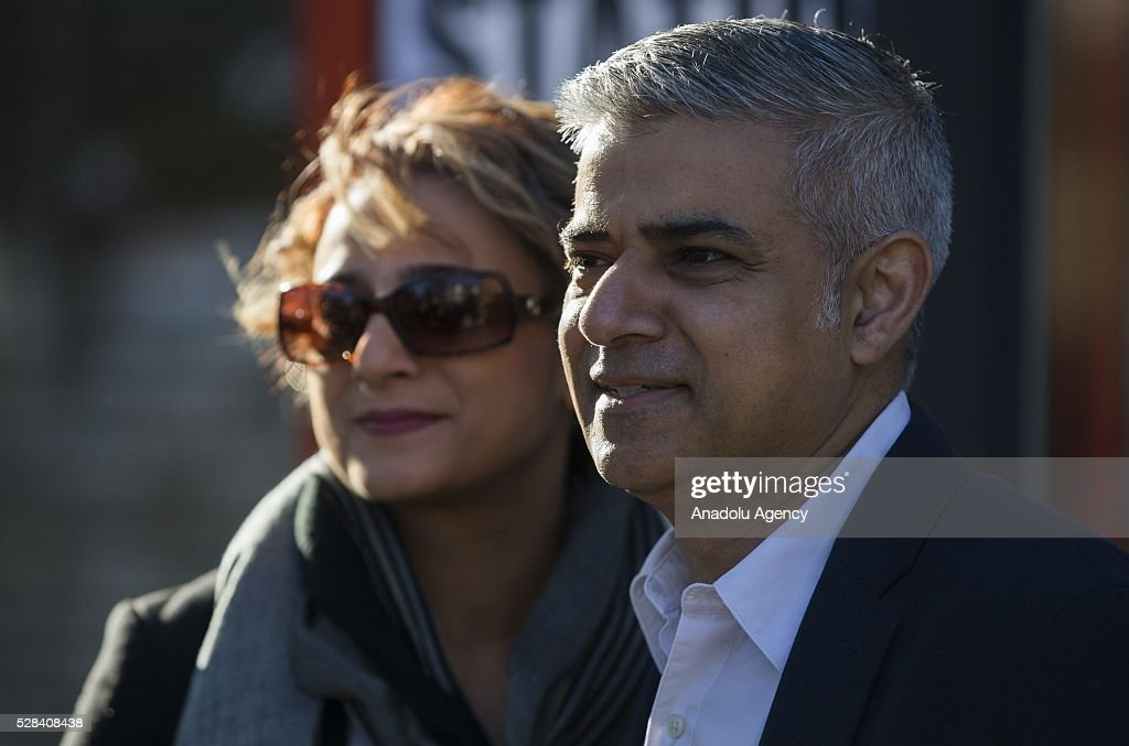 Britain's Labour Candidate for Mayor of London Sadiq Kahn (R) leaves polling station with his wife Saadiya after casting his vote, in south London, United Kingdom on May 5, 2016.