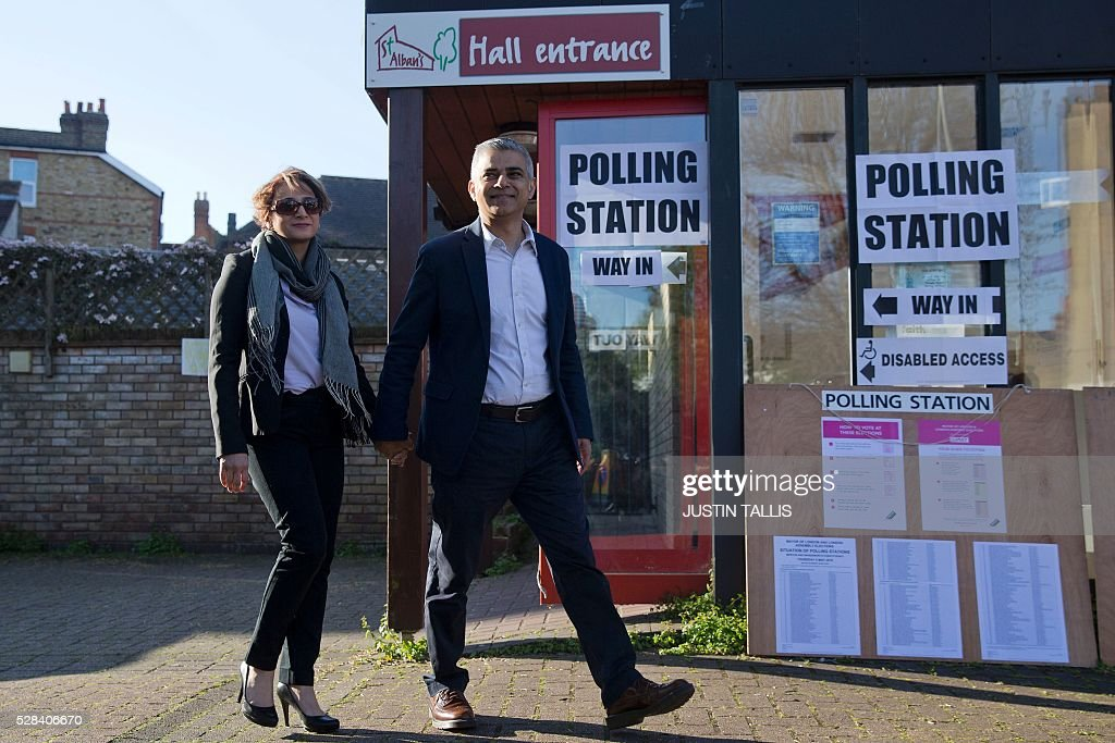 Britain's Labour party candidate for London Mayor Sadiq Khan (R) and his wife Saadiya leave a Polling Station in south London on May 5, 2016, after casting their votes. Londoners go to the polls on Thursday to elect their new mayor following a bitter campaign between the two leading candidates that stayed ugly to the very end. / AFP / JUSTIN